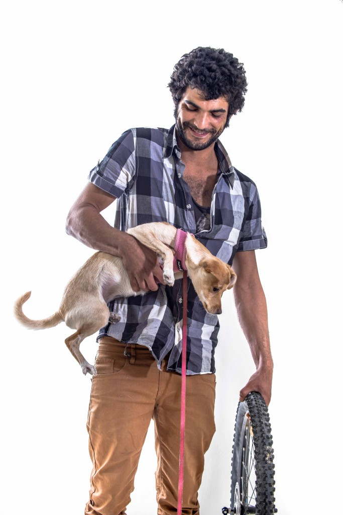 In Tel Aviv's bohemian center of Florentine, hipsters like Shachar (and puppy) blend global trends into the Mideast's un-self-conscious ease. Photo: The Tower/Aviram Valdman