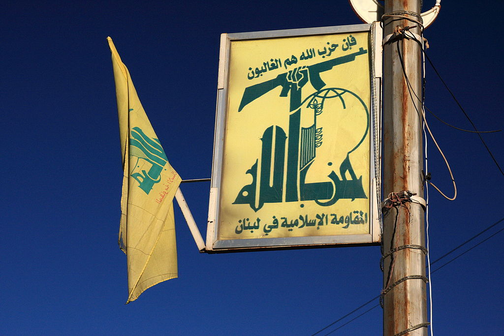 Hezbollah flag and logo in Baalbek, Lebanon. Maybe the gun gave them away? Photo: yeowatzup/wikimedia