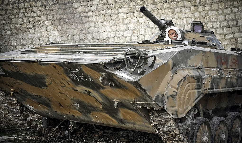 Syrian rebel mans a lonely personnel carrier. Photo: John Cantile/AFP/Getty/flickr