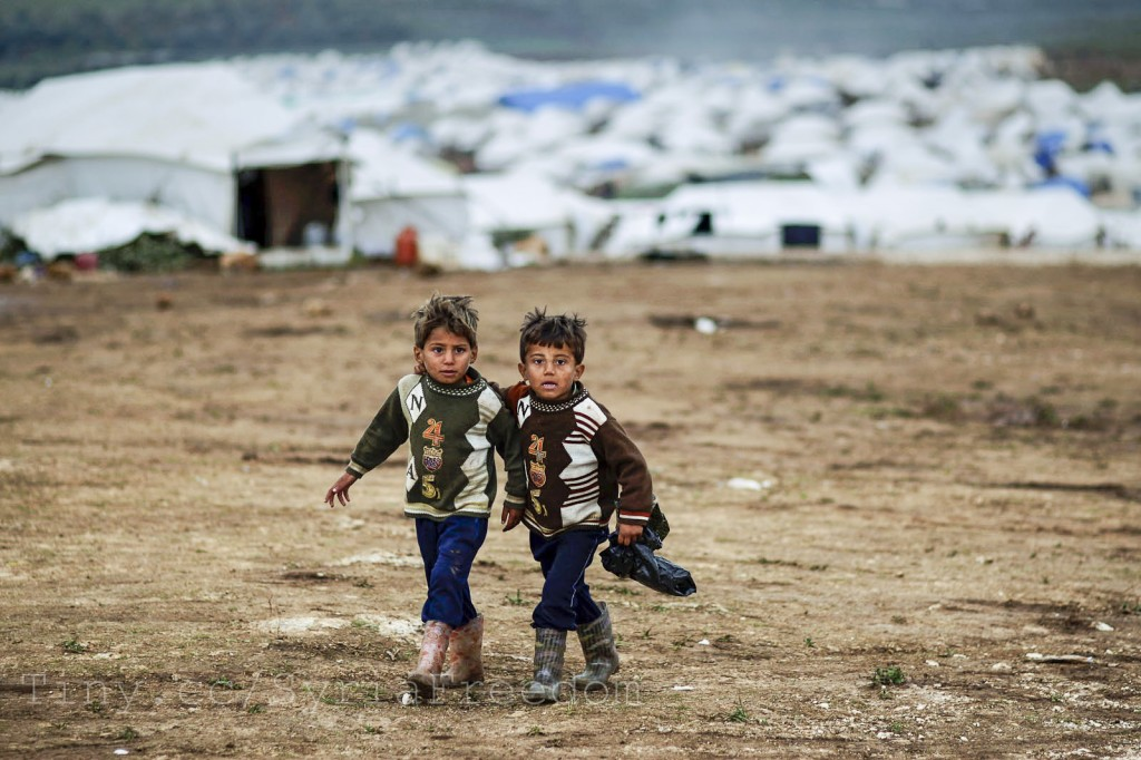 Syrian boys near their tent in a refugee camp in the village of Atmeh. Photo: FreedomHouse/Flickr