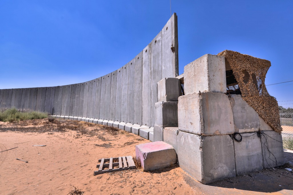 Concrete wall separating Kerem Shalom from the Gaza Strip. Photo: Aviram Valdman / The Tower