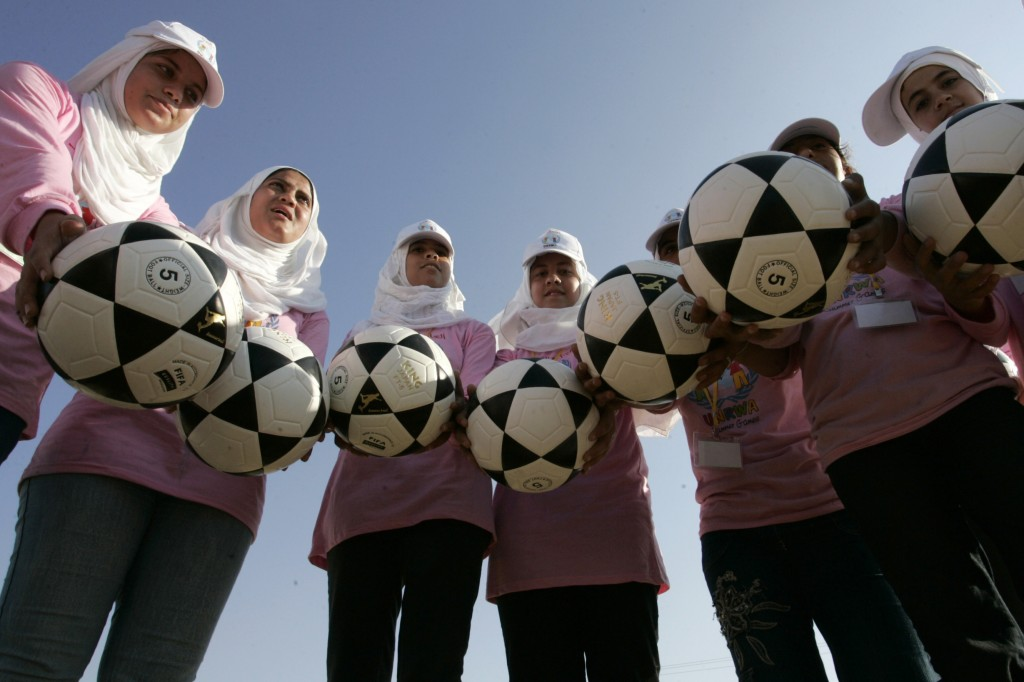 Your dollars at work: Gaza girls encouraged by UNRWA to break world record for most soccer balls bounced at the same time. Photo: Rahim Khatib / Flash90