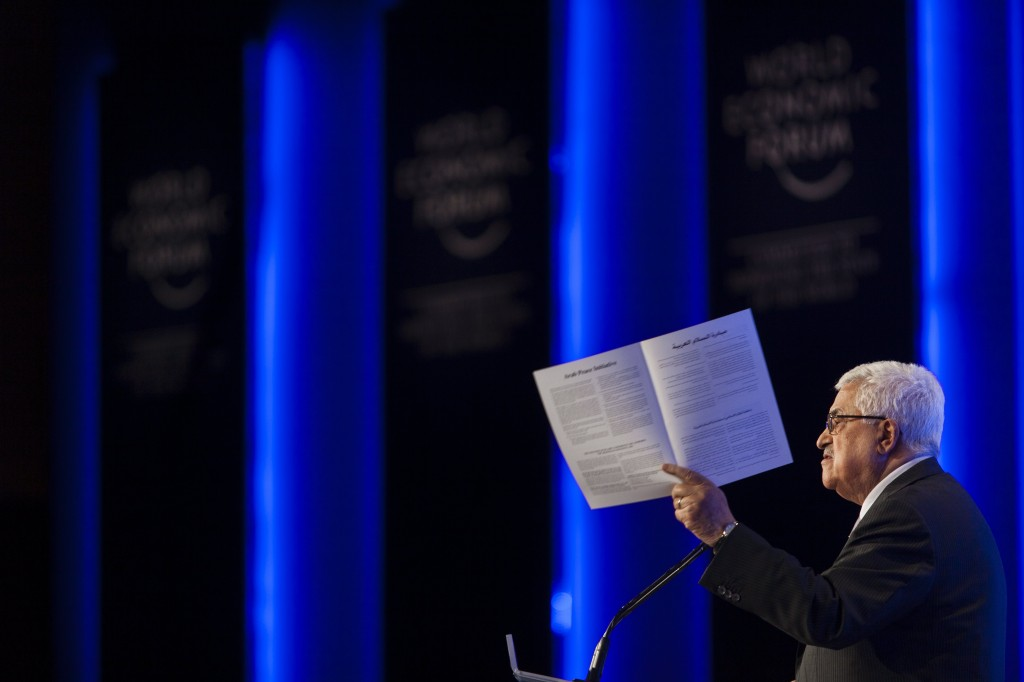 Palestinian Authority Chairman Mahmoud Abbas, holding the Arab peace initiative document, May 2013. Photo: Flash90