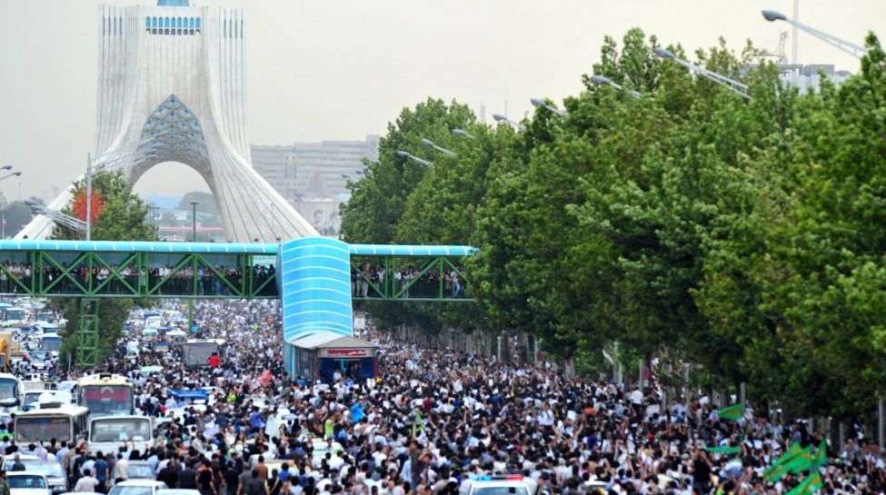 Protesters marching on Tehran's Azadi Tower during Iran's Green Revolution, June 15, 2009. Photo: Hamed Saber / Wikimedia