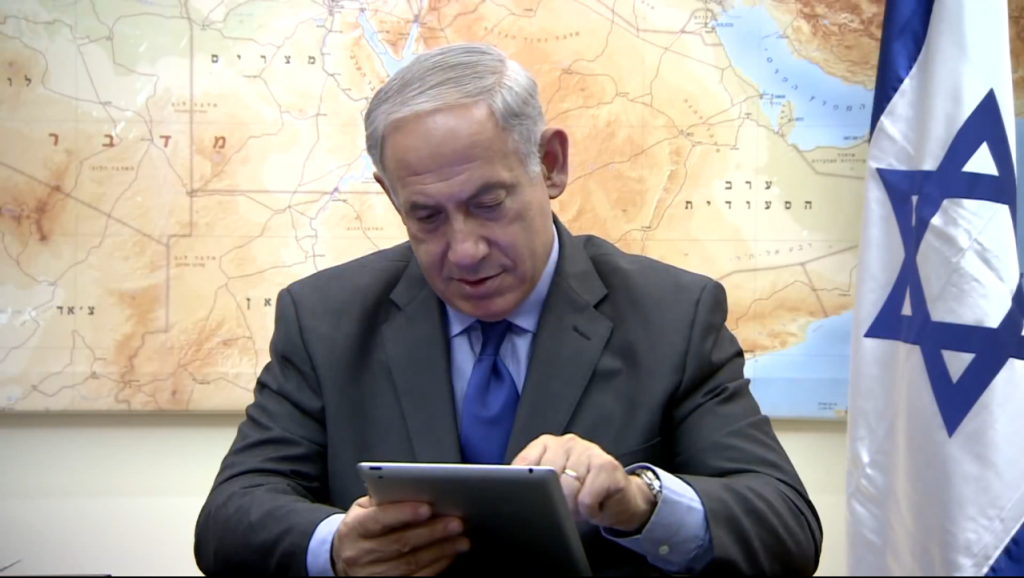 In a Rosh Hashanah greeting posted to YouTube, Israeli Prime Minister Benjamin Netanyahu plays Candy Crush. Photo: Yair Rosenberg / YouTube