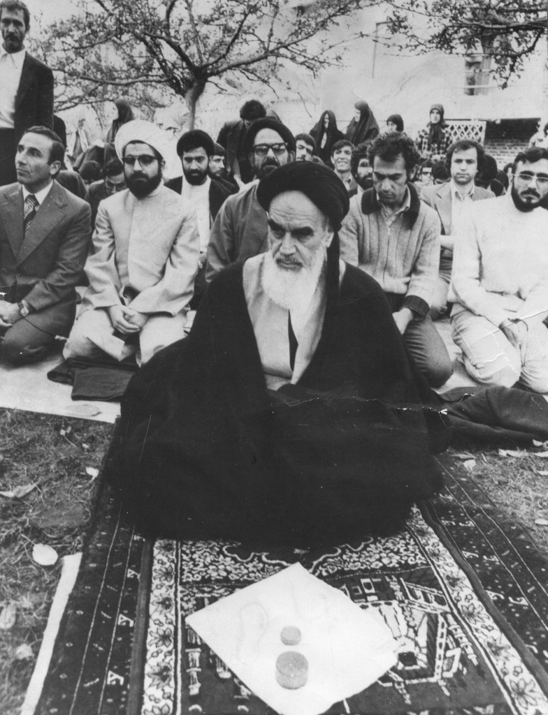 Ayatollah Khomeini praying in France. Hassan Rouhani is behind him, second from left. Photo credit: Mojtaba Salimi / Wikimedia