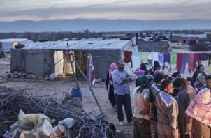 Syrian refugees have taken shelter at a makeshift tent camp set