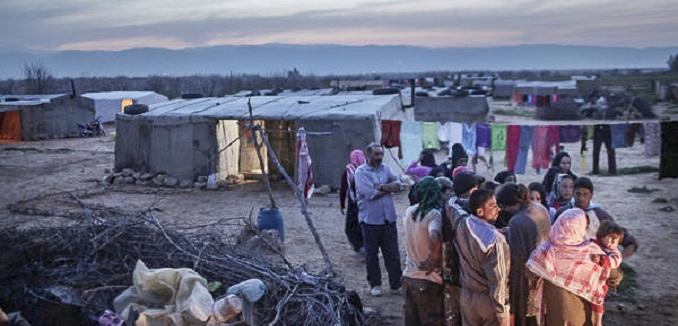 Syrian refugees have taken shelter at a makeshift tent camp set