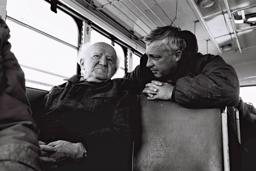 Major General Ariel Sharon talks with David Ben-Gurion during a bus ride along the Israeli Army positions on the Egyptian border.