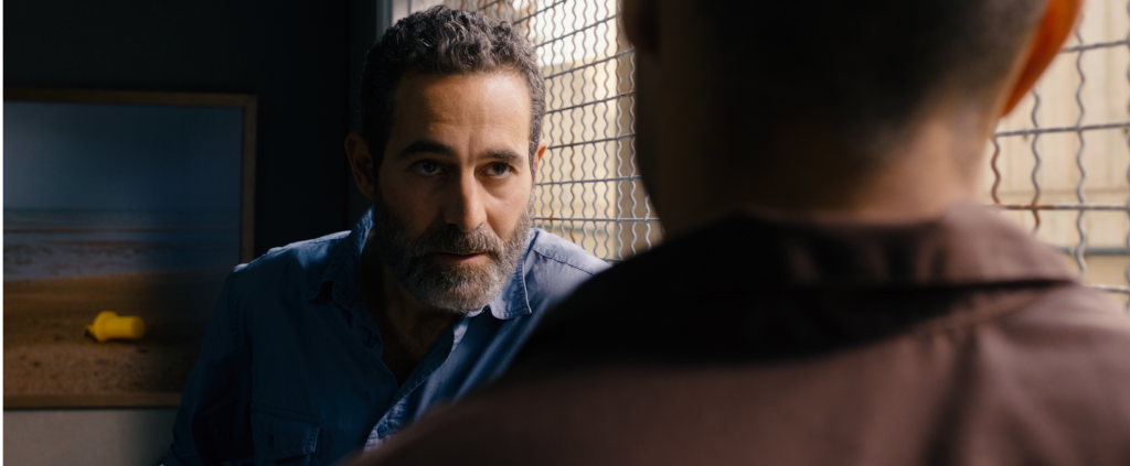 Rami (Waleed F. Zuaiter), an Israeli intelligence operative, makes a deal to free Omar from a long prison sentence in exchange for becoming a double agent. Photo: Adopt Films