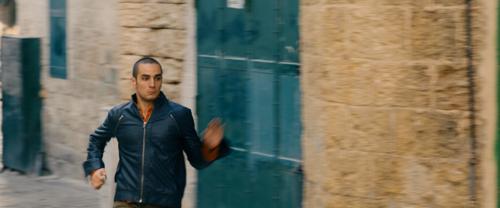 Omar (Adam Bakri) is on the run from Israeli agents who are pursuing the Palestinian murderer of an Israeli soldier. Photo: Adopt Films