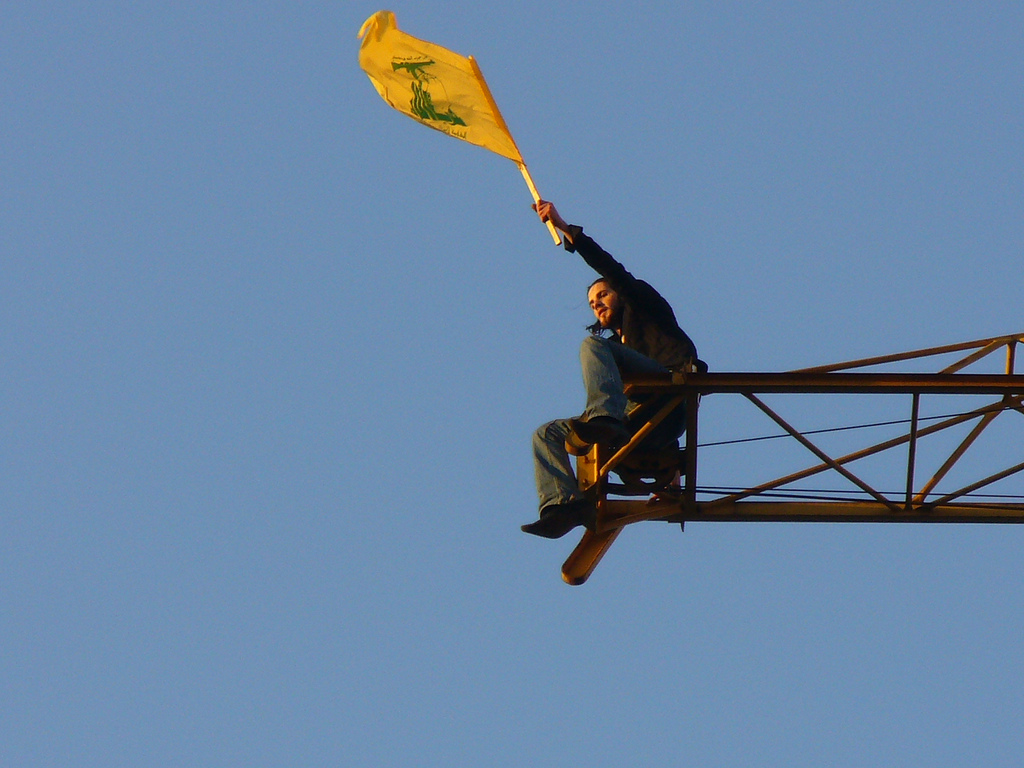 A Lebanese man waves the Hezbollah flag following the Second Lebanon War, 2006. Photo: Harout Arabian / Wikimedia