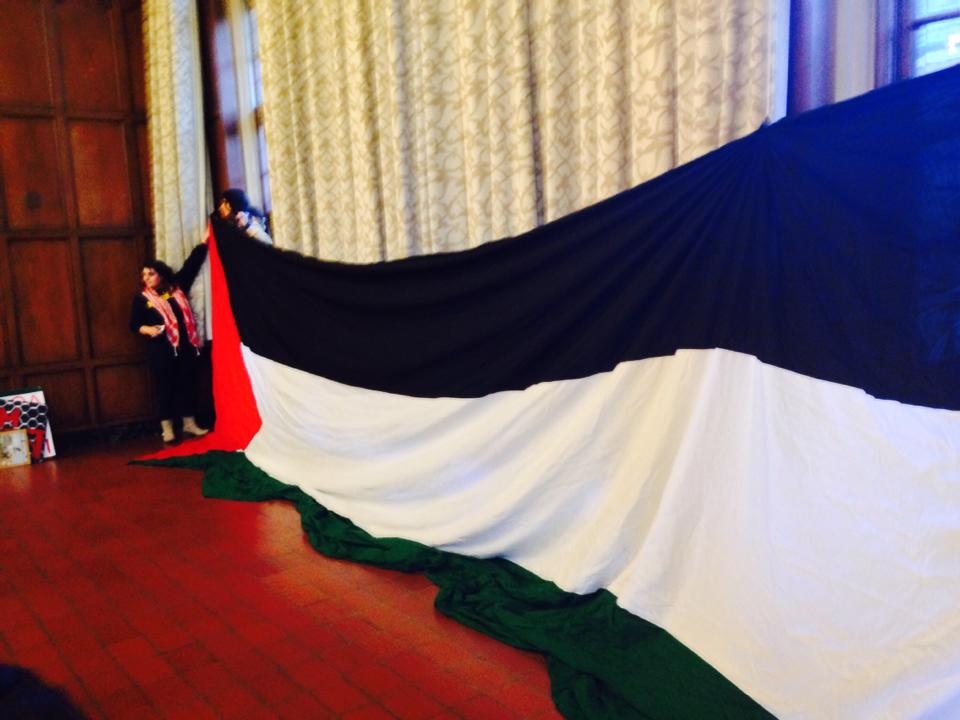A Palestinian flag unfurled at the Central Student Government's second vote on the BDS resolution. Photo: Ellie Geller