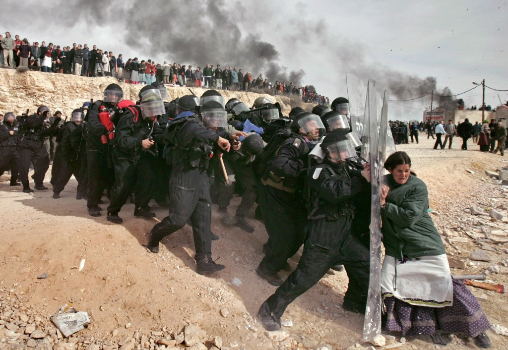 A Jewish settler struggles  with an Israeli security officer during clashes that erupted as authorities evacuated the West Bank settlement outpost of Amona, Feb. 1, 2006. Photo: Oded Balilty / AP / Knight Foundation / flickr
