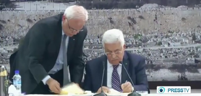 Palestinian Authority President Mahmoud Abbas signs documents for membership in UN organizations. Photo: PressTV / YouTube