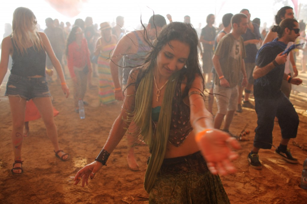 Israelis dance at a rave party in the Nahal Habesor in the south of Israel. Photo: Oren Nahshon / Flash90