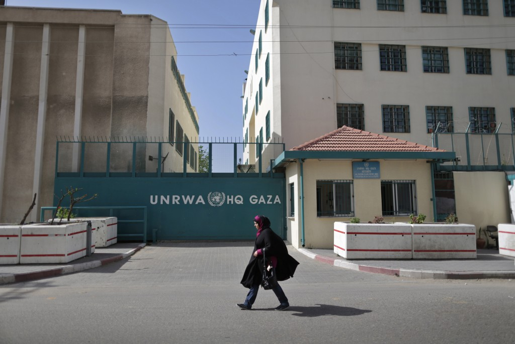 A Palestinian woman walks in front of the UNRWA building in Gaza City. Photo: Wissam Nassar/ Flash90