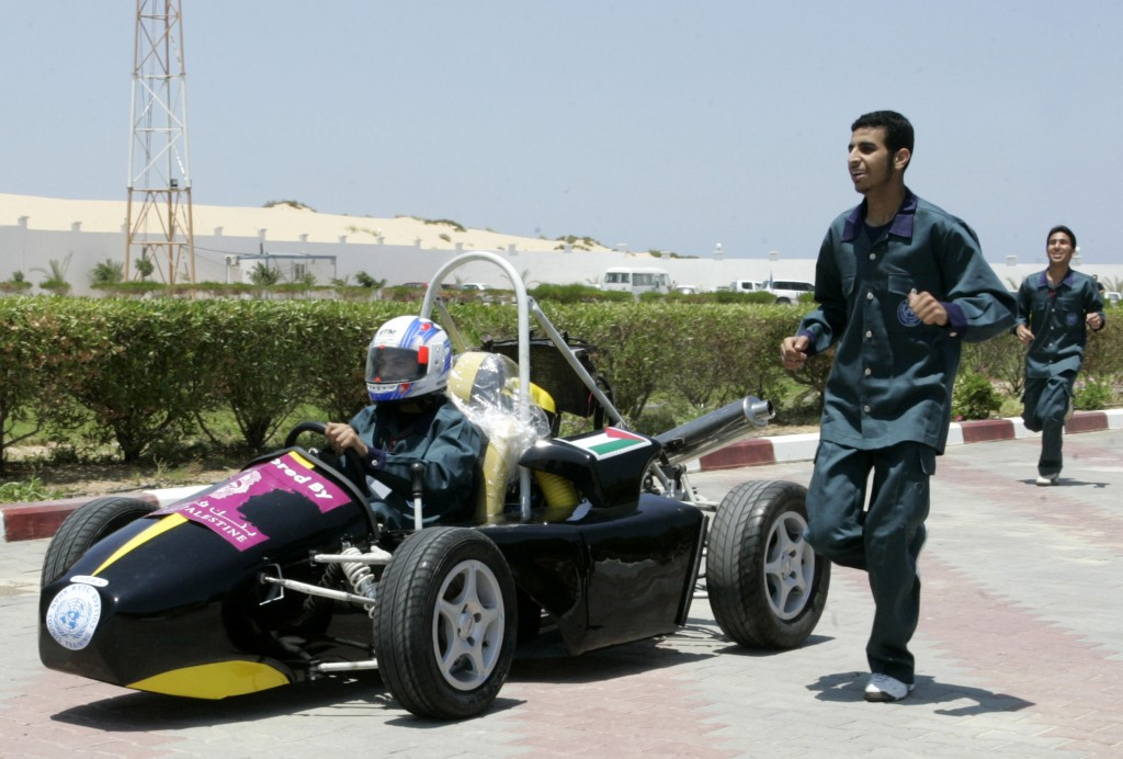 Palestinian students in an UNRWA college training  program test their Formula 1-style racecar in Khan Younis in the southern Gaza Strip. Photo: Abed Rahim Khatib / Flash 90