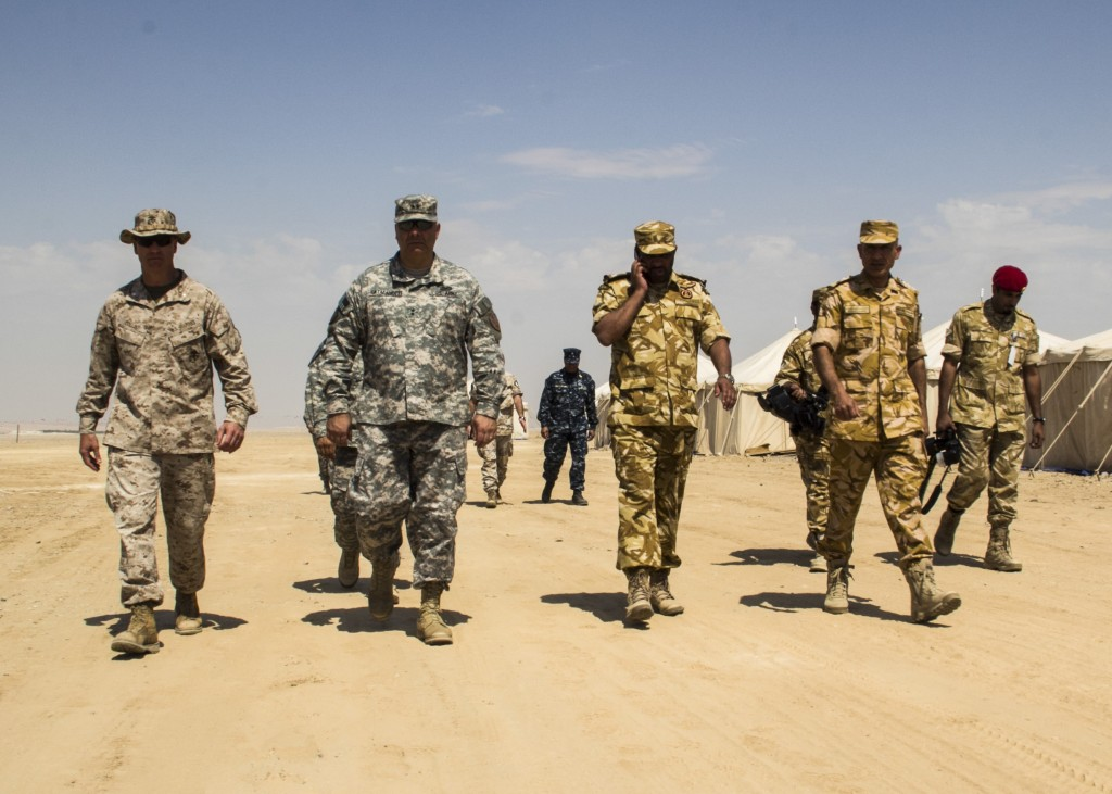 Officers from the United States Army and Marine Corps accompany officers from the Qatari Emiri Land Force during Eagle Resolve,  a multilateral military exercise that took place in Qatar in 2013. Photo: Juanenrique Owings / Wikimedia