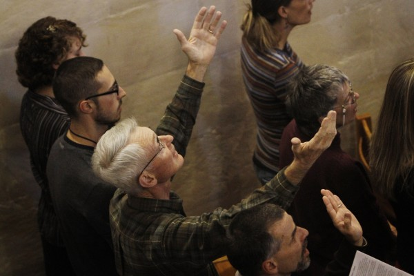 Kristine's family and friends pray for her soul at a memorial service at Christ Church in Jerusalem. Photo: Miriam Alster / Flash90