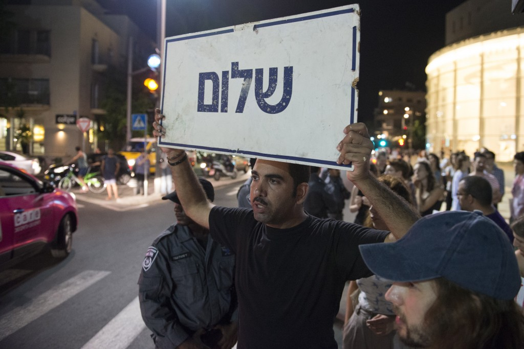 Left-wing activists rally at Habima Square, Tel Aviv, against the recent escalation of violence and racial hatred, July 3, 2014. Photo: Danielle Shitrit / Flash90