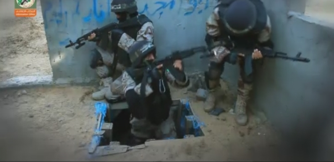 Hamas terrorists training to emerge from a tunnel.