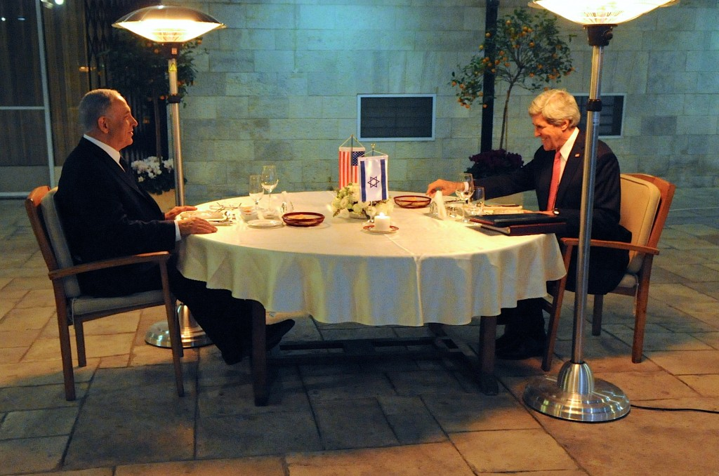 Israeli Prime Minister Benjamin Netanyahu and U.S. Secretary of State John Kerry settle into their seats in the courtyard of the Prime Minister's Residence in Jerusalem before a dinner meeting focused on Middle East peace on January 4, 2014. Photo: U.S. Department of State / Wikimedia