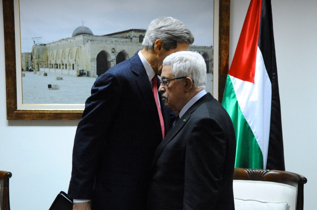 U.S. Secretary of State John Kerry has a private chat with Palestinian Authority President Mahmoud Abbas before a meeting in Ramallah, West Bank, on December 12, 2013. Photo: U.S. Department of State / Wikimedia
