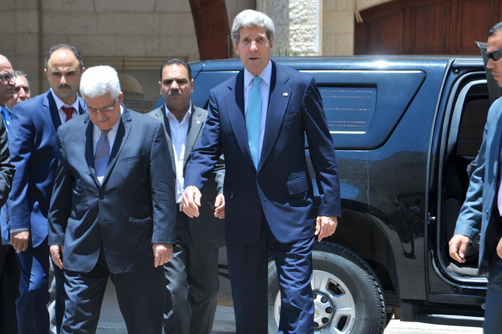 U.S. Secretary of State John Kerry and Palestinian Authority President Mahmoud Abbas approach a gaggle of reporters after concluding their meeting in Ramallah, West Bank, on June 30, 2013. Photo: U.S. Department of State / Wikimedia