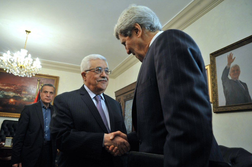 Palestinian Authority President Mahmoud Abbas greets U.S. Secretary of State John Kerry as he arrives for a meeting in Amman, Jordan, on June 29, 2013. Photo: U.S. Department of State / Wikimedia