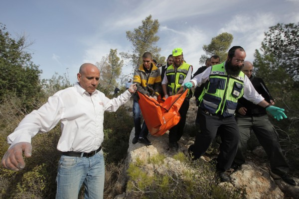 Officials remove Kristine's remains from the scene of her murder, December 2010. Photo: Nati Shohat / Flash90