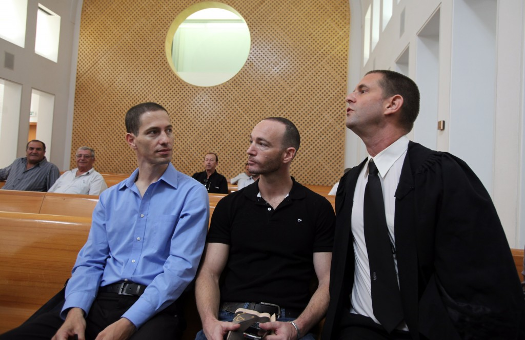 Etai Pinkas (L) and Yoav Arad (Middle), gay activists from Tel Aviv, with their attorney Dori Spibak (R), petitioned the Supreme Court in 2010 to be permitted to have a baby through a surrogate mother. Photo: Yossi Zamir / Flash90