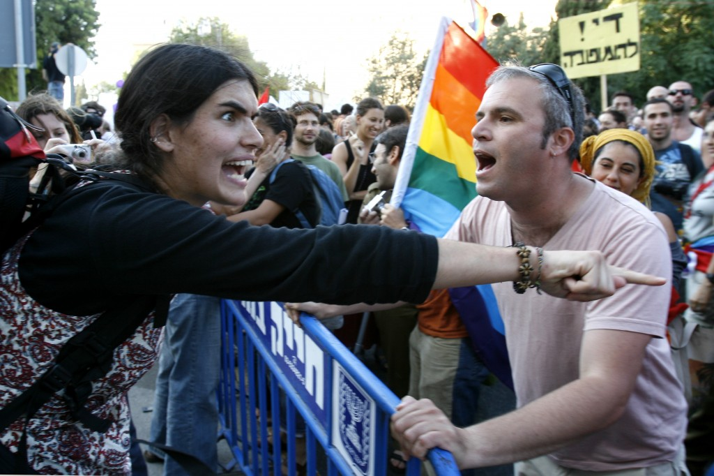 An Israeli gay man argues with a religious anti-gay protestor at the 2007 Jerusalem Gay Pride Parade. Photo: Nati Shohat / Flash90