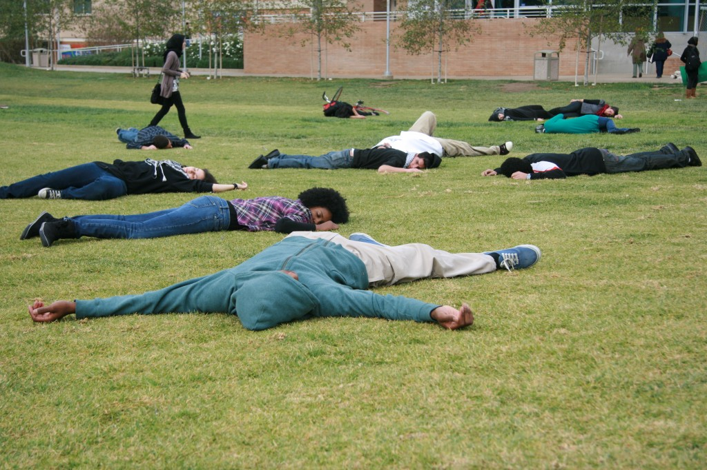 "SJP students take part in a ""die-in"" at UC Riverside. Photo: Scott Denny / flickr"