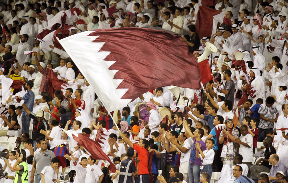 Fans cheer on their teams at a qualifying match for the 2014 World Cup between Qatar and Vietnam at Qatar's Al Sadd stadium. Photo: Vinod Divakaram / flickr