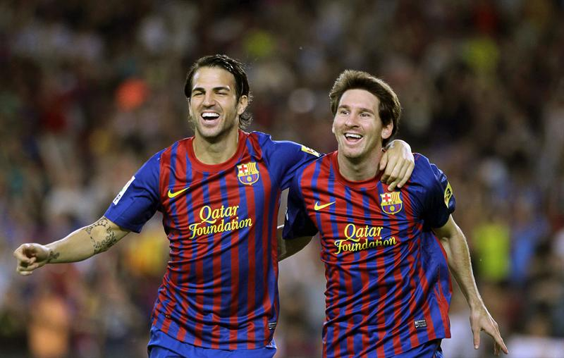 FC Barcelona's Lionel Messi (R) and Cesc Fabregas celebrate a goal. Photo: Globovisión / flickr