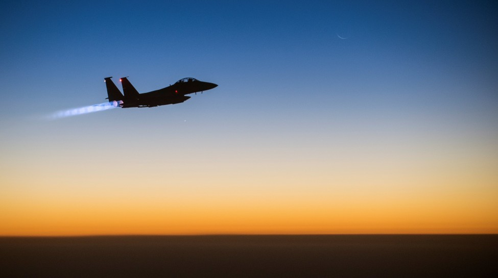 A U.S. Air Force F-15E Strike Eagle aircraft flies over northern Iraq Sept. 23, 2014, after conducting airstrikes in Syria. The aircraft was part of a large coalition strike package that was the first to strike Islamic State targets in Syria. Photo: Stuart Rankin / flickr