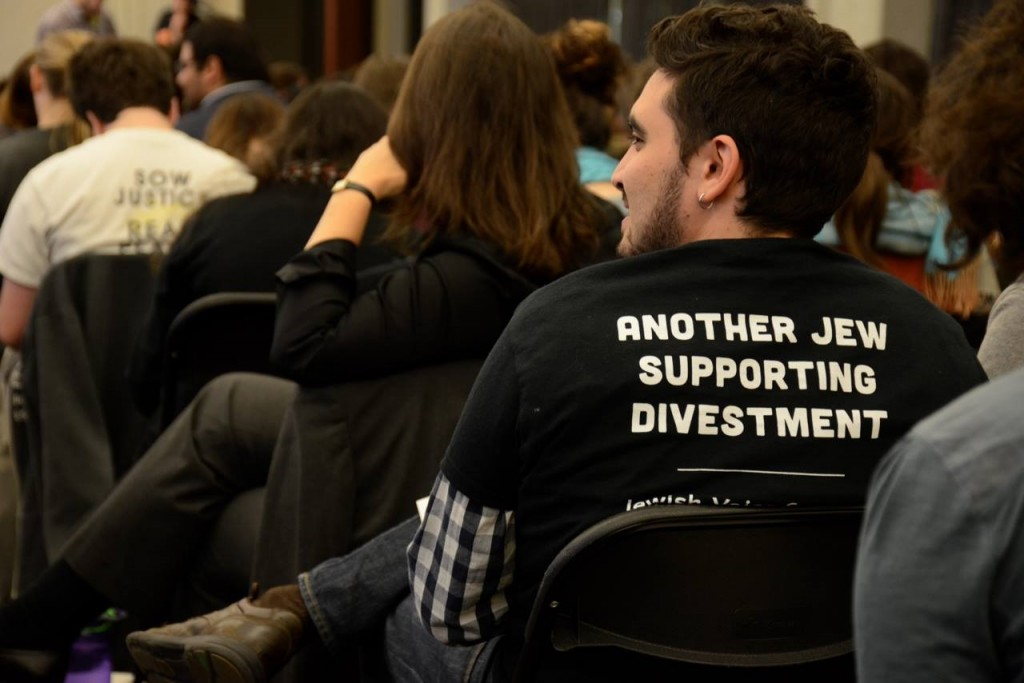 A supporter of Jewish Voice for Peace attends a session at the Open Hillel Conference. Photo: Gili Getz