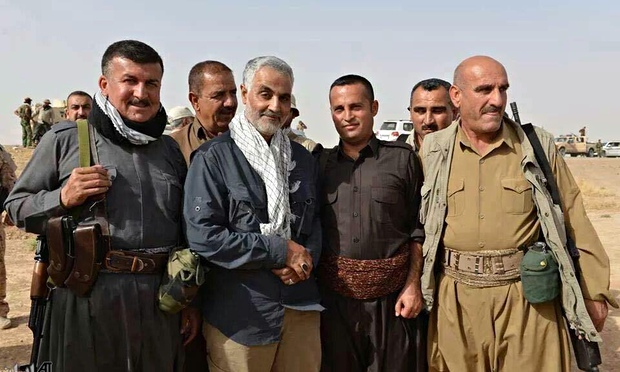 Qassem Suleimani (center, with scarf), the commander of the Iranian Revolutionary Guards Corps-Quds Force, poses with a group of peshmerga fighters in Kurdistan. Photo: Iranian television