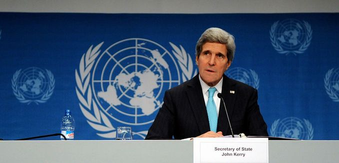 FeaturedImage_2014-11-05_WikiCommons_Secretary_Kerry_Addresses_Reporters_After_Geneva_II_Meeeting_(12091068915)