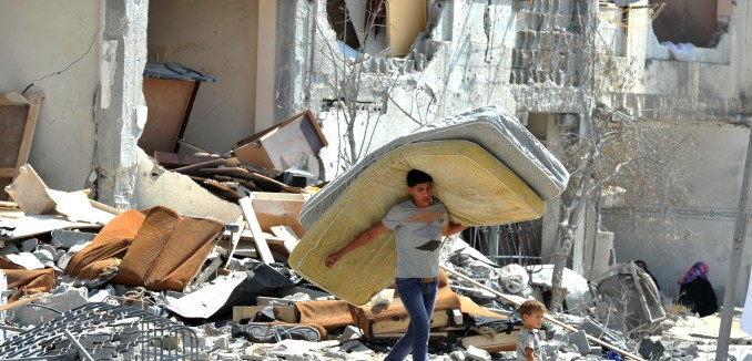 Palestinians searches through rubble