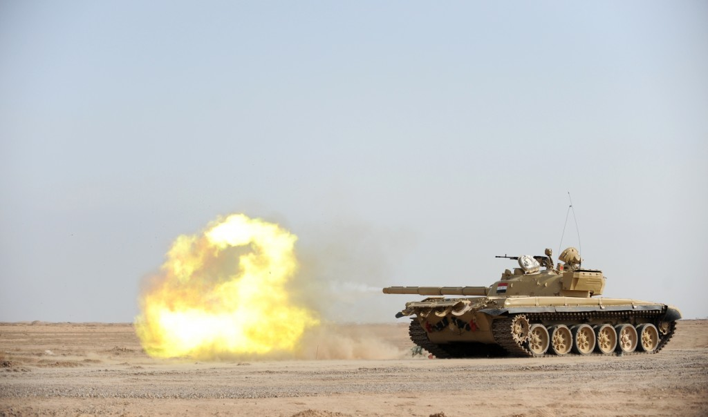An Iraqi T-72 tank fires during a live fire training exercise at the Besmaya Gunnery Range near Baghdad. Photo: Jacob H. Smith / U.S. Army / Wikimedia