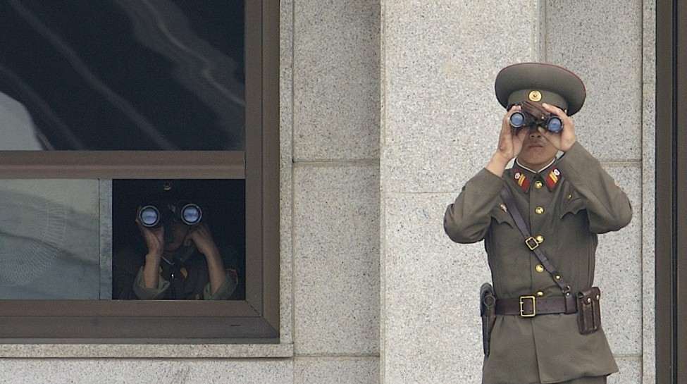 Soldiers from the North Korean army stand watch over the Demilitarized Zone. Photo: Edward N. Johnson / U.S. Army / Wikimedia