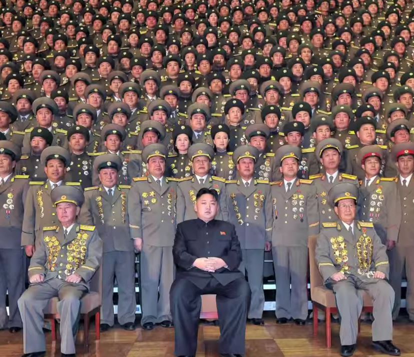 Kim Jong Il sits amid North Korean military leaders. Photo: CNN / YouTube