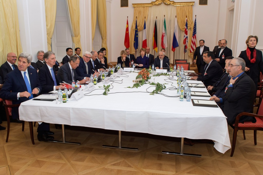 Foreign Ministers from the P5+1 nations - John Kerry of the United States, Philip Hammond of the United Kingdom, Sergey Lavrov of Russia, Frank-Walter Steinmeier of Germany, Laurent Fabius of France, and Wang Yi of China - sit at a table with Baroness Catherine Ashton of the European Union and Foreign Minister Mohammad Javad Zarif of Iran and his delegation in Vienna, Austria, on November 24, 2014, before a multilateral meeting about the future of Iran's nuclear program. Photo: U.S. Department of State / flickr