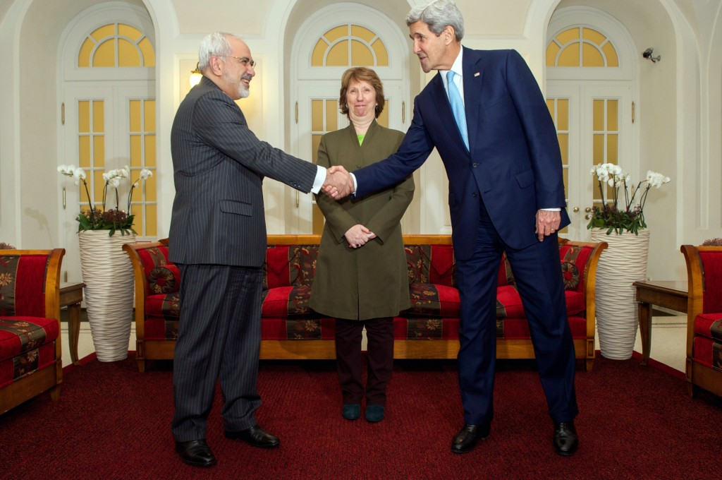U.S. Secretary of State John Kerry shakes hands with Foreign Minister Mohammad Javad Zarif of Iran while watched by Baroness Catherine Ashton of the European Union before sitting down in Vienna, Austria, on November 20, 2014, for a three-way discussion about the future of Iran's nuclear program. Photo: U.S. Department of State / flickr