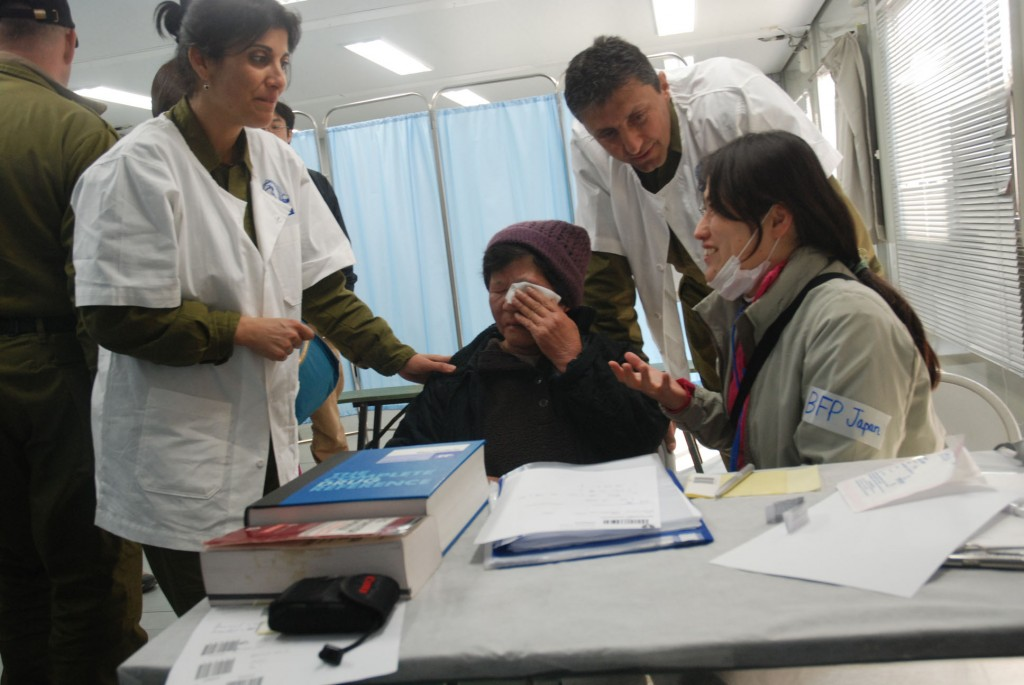 An Israeli medical delegation traveled to Japan to assist after the devastating earthquake and tsunami in 2011. Following publications in Japanese news outlets regarding the opening of an Israeli medical clinic in Minamisanriku, Setsukao Yamauchi, an 80-year-old woman, walked three hours from her distant village to be treated by Lt. Col. Dr. Orly Weinstein, an Israeli eye specialist. Photo: Israel Defense Forces / Wikimedia