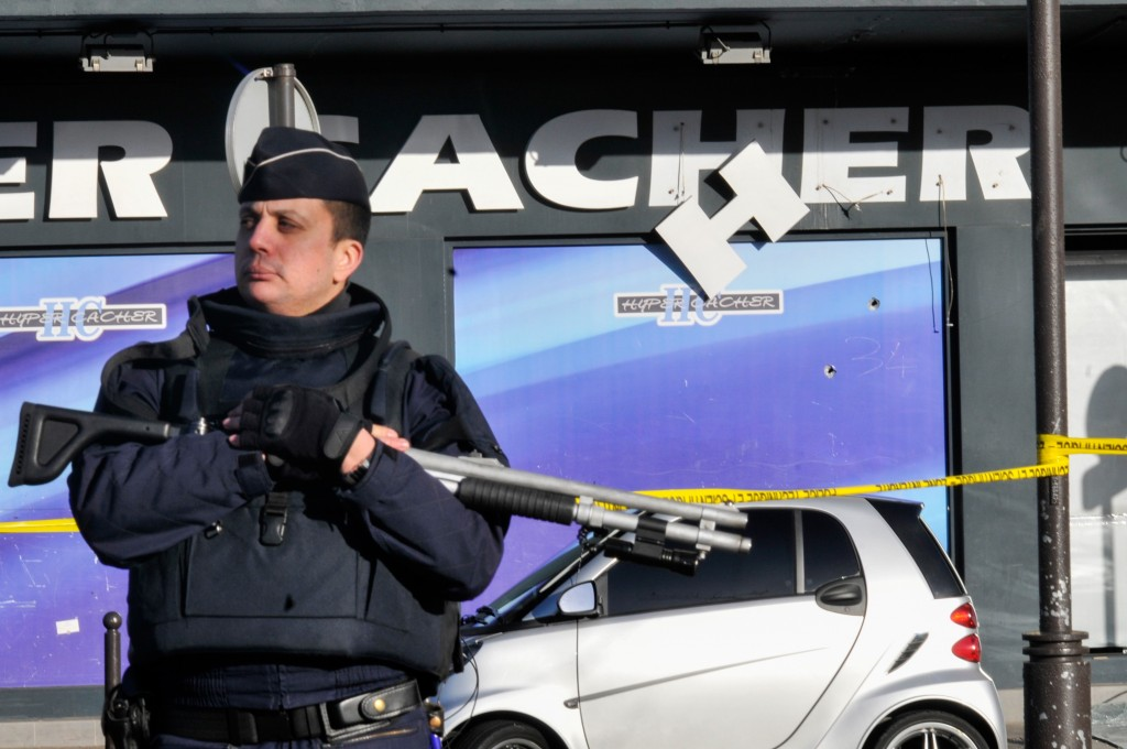 Security stands guard outside the kosher supermarket in Paris where four Jewish men were murdered when held hostage by an Islamist gunman. Photo: Serge Attal / Flash90