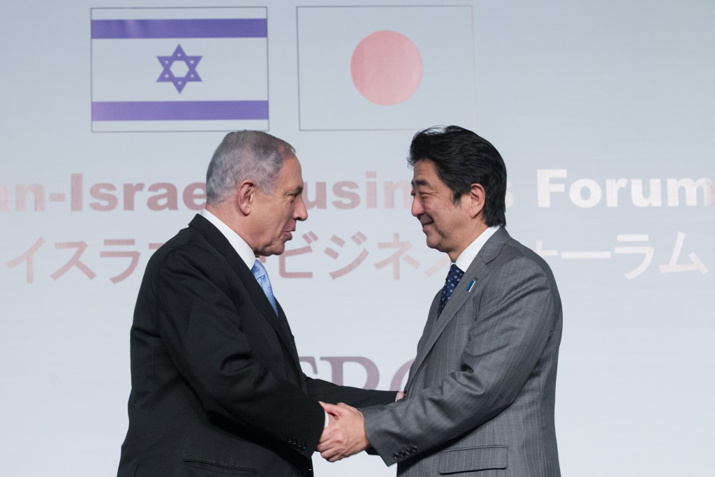 Israeli Prime Minister Benjamin Netanyahu greets his Japanese counterpart Shinzo Abe at the Japan-Israel Business Forum, held at the Waldorf Astoria Hotel in Jerusalem, January 18, 2015. Photo: Miriam Alster / Flash90