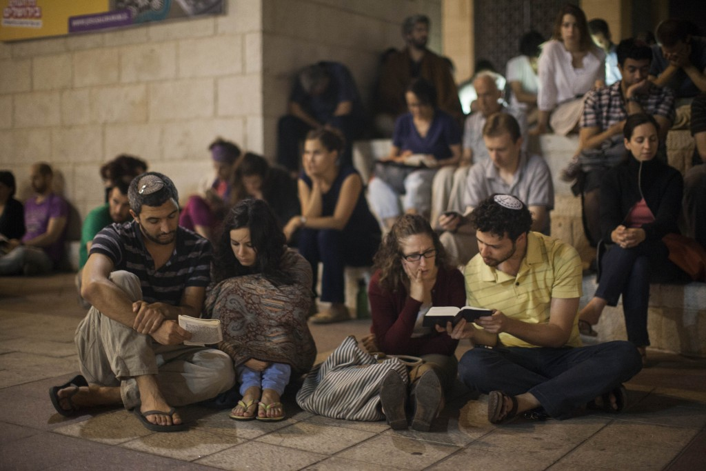 Conservative Jews pray as they gather for the mournful holiday of Tisha B'Av at Safra Square in Jerusalem, July 15, 2013. Photo: Yonatan Sindel / Flash90.